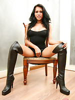 Raven haired girl in knee-high leather boots with a rock hard cock.